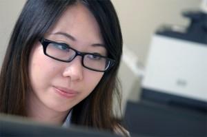 Scitek Employee at desk